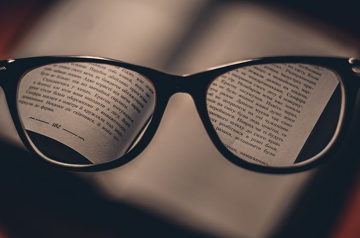 a book and a pair of prescription glasses