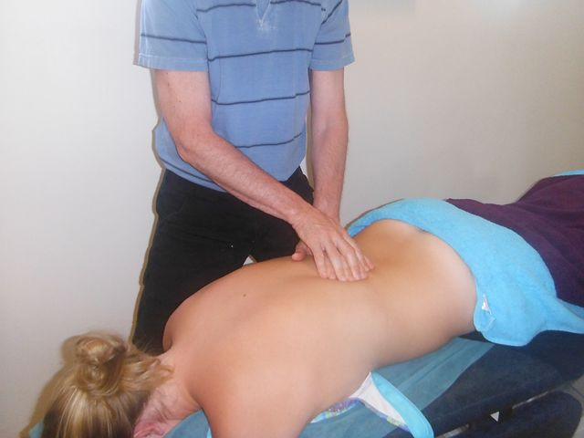 Norwest Chiropractor treating a female patient