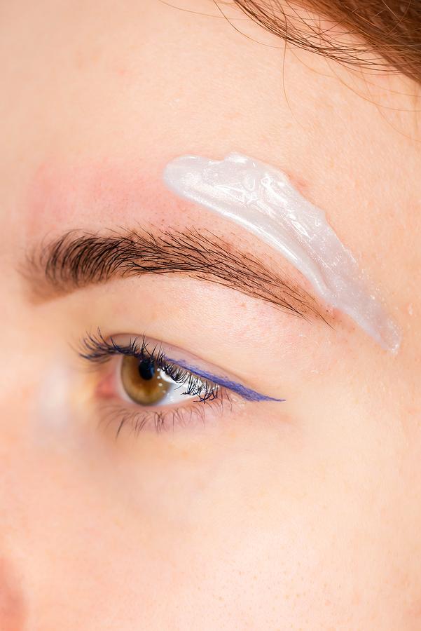 Beautician in Sydney CBD applying wax in a woman's brows