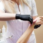 Beautician in Sydney CBD waxing a woman's arms