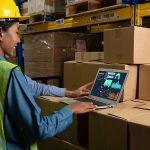 Female warehouse worker using MYOB Advanced software